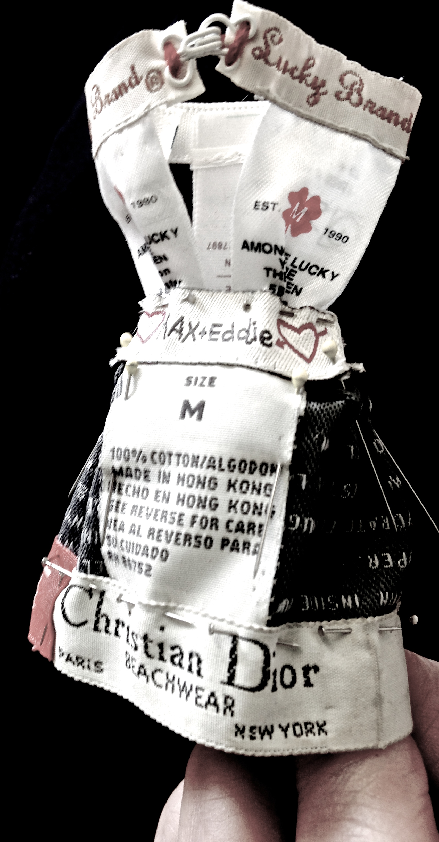 Miniature clothing made of cut labels