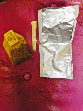 Unwrapped tea bag with packaging